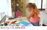 Купить «creative girl making greeting card at home», видеоролик № 31844655, снято 21 июля 2019 г. (c) Syda Productions / Фотобанк Лори
