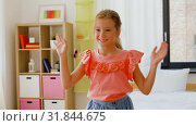 Купить «happy little girl dancing in her room at home», видеоролик № 31844675, снято 21 июля 2019 г. (c) Syda Productions / Фотобанк Лори