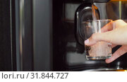 Купить «hand with glass and water pouring from dispenser», видеоролик № 31844727, снято 21 июля 2019 г. (c) Syda Productions / Фотобанк Лори