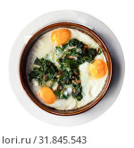 Купить «Fried eggs with spinach, raisins and ham, dish of Catalan cuisine», фото № 31845543, снято 20 сентября 2019 г. (c) Яков Филимонов / Фотобанк Лори