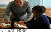 Купить «Male teacher teaching students in the classroom 4k», видеоролик № 31845691, снято 8 августа 2018 г. (c) Wavebreak Media / Фотобанк Лори