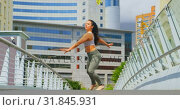 Купить «Beautiful young ballerina practicing dance on the bridge in the city 4k», видеоролик № 31845931, снято 26 сентября 2018 г. (c) Wavebreak Media / Фотобанк Лори