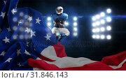 Купить «Digital animation of American Rugby player catching the ball in the stadium 4K», видеоролик № 31846143, снято 12 ноября 2018 г. (c) Wavebreak Media / Фотобанк Лори