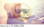 Купить «Smiley with sunglasses on the beach», видеоролик № 31846339, снято 20 ноября 2018 г. (c) Wavebreak Media / Фотобанк Лори