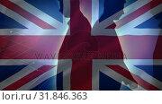 Flag of the UK and men walking . Стоковое видео, агентство Wavebreak Media / Фотобанк Лори