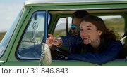 Купить «Smiling beautiful woman pointing finger showing something to man in car 4k», видеоролик № 31846843, снято 20 сентября 2018 г. (c) Wavebreak Media / Фотобанк Лори