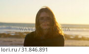 Купить «Portrait of beautiful young woman on beach during sunset 4k», видеоролик № 31846891, снято 20 сентября 2018 г. (c) Wavebreak Media / Фотобанк Лори