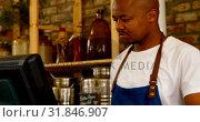 Купить «Male staff working at counter in supermarket 4k», видеоролик № 31846907, снято 13 сентября 2018 г. (c) Wavebreak Media / Фотобанк Лори