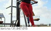 Купить «Disabled woman exercising in the park 4k», видеоролик № 31847015, снято 2 октября 2018 г. (c) Wavebreak Media / Фотобанк Лори