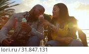 Купить «Disabled woman feeding ice cream to man on a sunny day 4k», видеоролик № 31847131, снято 2 октября 2018 г. (c) Wavebreak Media / Фотобанк Лори