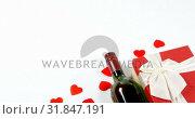 Купить «Wine bottle, gift box and scattered red hearts on white surface 4k», видеоролик № 31847191, снято 11 октября 2018 г. (c) Wavebreak Media / Фотобанк Лори