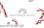 Купить «Animation of party candy against white background», видеоролик № 31847227, снято 26 ноября 2018 г. (c) Wavebreak Media / Фотобанк Лори