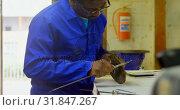 Купить «Worker using caliper at table in foundry workshop 4k», видеоролик № 31847267, снято 27 сентября 2018 г. (c) Wavebreak Media / Фотобанк Лори