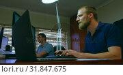 Купить «Male robotic engineers working at desk in office 4k», видеоролик № 31847675, снято 4 октября 2018 г. (c) Wavebreak Media / Фотобанк Лори