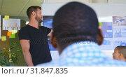 Купить «Young mixed race business team planning and sitting in modern office 4k», видеоролик № 31847835, снято 29 сентября 2018 г. (c) Wavebreak Media / Фотобанк Лори