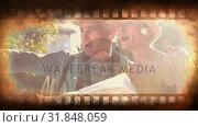 Купить «Old Movie tape video», видеоролик № 31848059, снято 5 декабря 2018 г. (c) Wavebreak Media / Фотобанк Лори