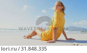 Купить «Side view of young Caucasian woman relaxing on the beach 4k», видеоролик № 31848335, снято 6 ноября 2018 г. (c) Wavebreak Media / Фотобанк Лори