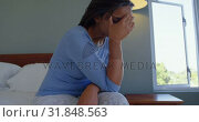 Купить «Side view of mature Caucasian woman sitting on bed with hand on forehead in comfortable home 4k», видеоролик № 31848563, снято 7 ноября 2018 г. (c) Wavebreak Media / Фотобанк Лори