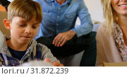 Купить «Front view of young Caucasian family packing their belongings in a comfortable home 4k», видеоролик № 31872239, снято 6 ноября 2018 г. (c) Wavebreak Media / Фотобанк Лори