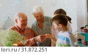 Caucasian grandfather giving chocolate to grandson in a comfortable home 4k. Стоковое видео, агентство Wavebreak Media / Фотобанк Лори