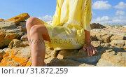 Купить «Front view of young Caucasian woman relaxing on the rock at beach 4k», видеоролик № 31872259, снято 6 ноября 2018 г. (c) Wavebreak Media / Фотобанк Лори