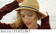 Купить «Front view of young beautiful caucasian woman in hat on the beach 4k», видеоролик № 31872967, снято 14 ноября 2018 г. (c) Wavebreak Media / Фотобанк Лори