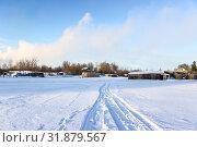 Купить «Road on snow and ice of frozen lake, tracks going to village, sunny cold weather», фото № 31879567, снято 9 января 2017 г. (c) Кекяляйнен Андрей / Фотобанк Лори