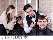 Купить «Male discussing haircut with hairdresser», фото № 31879791, снято 5 марта 2018 г. (c) Яков Филимонов / Фотобанк Лори