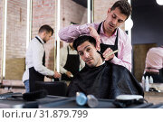 Купить «Man during beard shaving in barbershop», фото № 31879799, снято 5 марта 2018 г. (c) Яков Филимонов / Фотобанк Лори