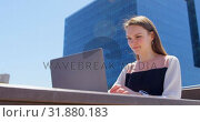 Купить «Front view of young cool caucasian businesswoman working on laptop in balcony of modern office 4k», видеоролик № 31880183, снято 13 октября 2018 г. (c) Wavebreak Media / Фотобанк Лори