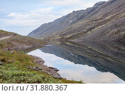 Купить «Beautiful views from the way through the Khibiny Mountains, calm lakes and tundra. Kolsky peninsula, northern Russia», фото № 31880367, снято 18 июля 2015 г. (c) Кекяляйнен Андрей / Фотобанк Лори