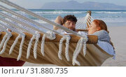 Купить «Front view of young romantic caucasian couple relaxing in hammock at beach on a sunny day 4k», видеоролик № 31880735, снято 14 ноября 2018 г. (c) Wavebreak Media / Фотобанк Лори