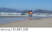 Купить «Romantic couple walking together at beach 4k», видеоролик № 31881339, снято 14 ноября 2018 г. (c) Wavebreak Media / Фотобанк Лори