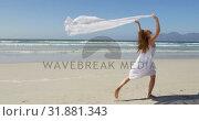 Купить «Woman running by the sea with awaving scarf.at beach 4k», видеоролик № 31881343, снято 14 ноября 2018 г. (c) Wavebreak Media / Фотобанк Лори
