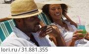 Купить «Couple having cocktail drinks at beach 4k», видеоролик № 31881355, снято 14 ноября 2018 г. (c) Wavebreak Media / Фотобанк Лори