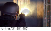 Купить «Rear view of caucasian military soldier firing with pistol on rubber dummies during training 4k», видеоролик № 31881487, снято 27 июня 2018 г. (c) Wavebreak Media / Фотобанк Лори
