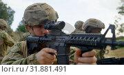 Купить «Rear view of mixed-race military soldiers rifle training in fields during military training 4k », видеоролик № 31881491, снято 27 июня 2018 г. (c) Wavebreak Media / Фотобанк Лори