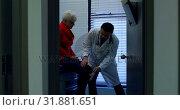 Купить «Young Asian male doctor examining a senior patient with reflex hammer in the clinic 4k», видеоролик № 31881651, снято 25 ноября 2018 г. (c) Wavebreak Media / Фотобанк Лори