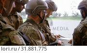 Купить «Side view of mixed-race military soldiers with rifle planning during military training 4k», видеоролик № 31881775, снято 27 июня 2018 г. (c) Wavebreak Media / Фотобанк Лори