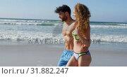 Купить «Romantic couple walking together at beach 4k», видеоролик № 31882247, снято 14 ноября 2018 г. (c) Wavebreak Media / Фотобанк Лори
