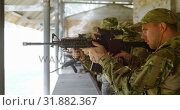 Купить «Side view of mixed-race military soldiers shooting rifle in target practice during training 4k», видеоролик № 31882367, снято 27 июня 2018 г. (c) Wavebreak Media / Фотобанк Лори