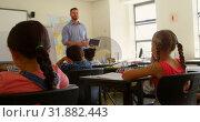 Купить «Caucasian male schoolteacher using digital tablet while teaching in classroom 4k», видеоролик № 31882443, снято 10 ноября 2018 г. (c) Wavebreak Media / Фотобанк Лори