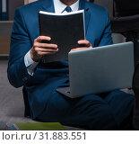 Купить «Businessman working overtime long hours late in office», фото № 31883551, снято 9 октября 2017 г. (c) Elnur / Фотобанк Лори