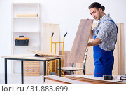 Купить «Young male carpenter working indoors», фото № 31883699, снято 9 апреля 2019 г. (c) Elnur / Фотобанк Лори
