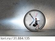 Купить «Businesswoman employee in time management concept», фото № 31884135, снято 10 июля 2020 г. (c) Elnur / Фотобанк Лори