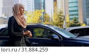 Купить «Side view of young Asian woman in hijab using smartwatch in the city 4k», видеоролик № 31884259, снято 15 октября 2018 г. (c) Wavebreak Media / Фотобанк Лори