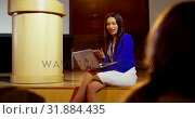 Купить «Young mixed-race businesswoman with laptop speaking in seminar at auditorium 4k», видеоролик № 31884435, снято 15 ноября 2018 г. (c) Wavebreak Media / Фотобанк Лори