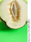 Купить «Half fresh melon on green background.», фото № 31897051, снято 26 июля 2019 г. (c) easy Fotostock / Фотобанк Лори
