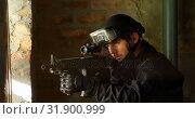 Купить «Side view of caucasian soldier aiming with a rifle during military exercise at base 4k», видеоролик № 31900999, снято 27 июня 2018 г. (c) Wavebreak Media / Фотобанк Лори