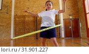 Купить «Schoolgirl playing with ring in school gym at elementary school 4k», видеоролик № 31901227, снято 10 ноября 2018 г. (c) Wavebreak Media / Фотобанк Лори
